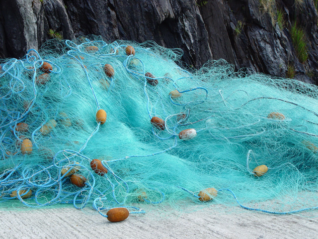 Image of fishing net with floats placed on the floor