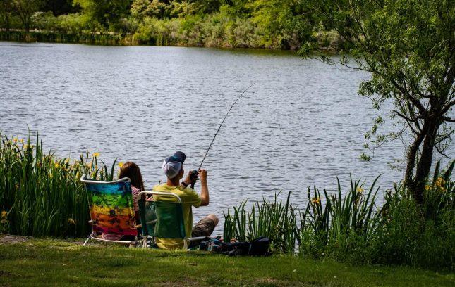 A Couple fishing in a beautiful lake
