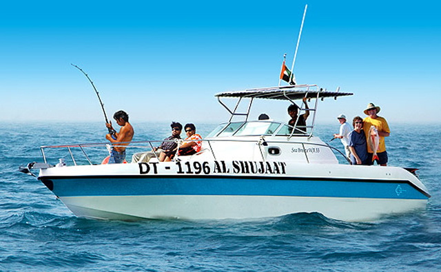 Group of Tourist fishing from an electric boat on the sea