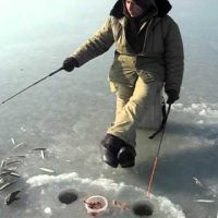 A man trying to catch smelts
