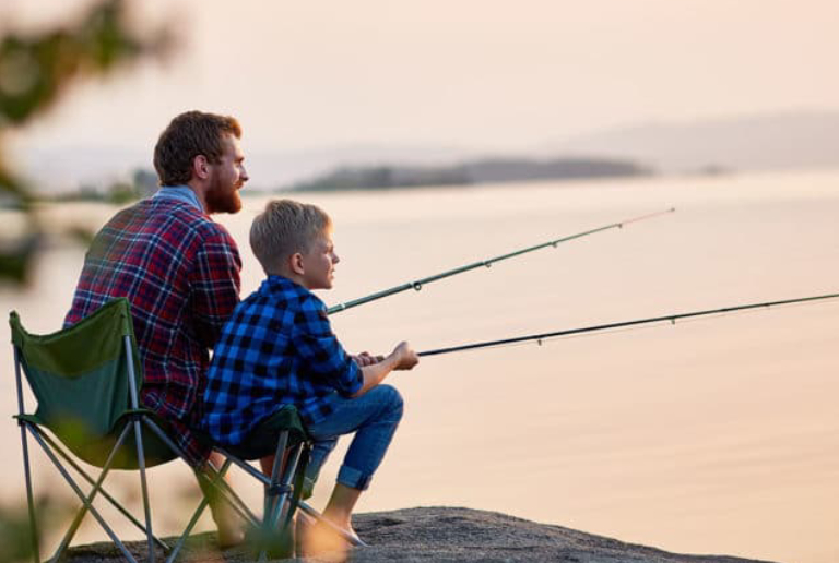 A Father & Son Getting Relaxed While Fishing.