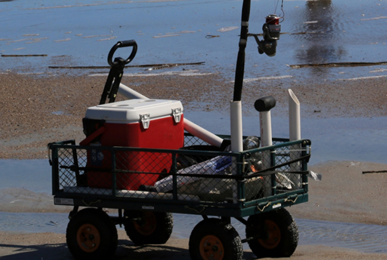 A Cart With Fishing Supplies Is Ready For A Fisherman's Use.