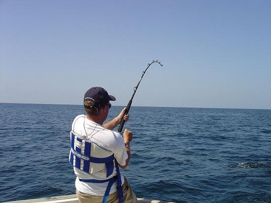 A Man Polefishing In The Deep Sea.